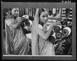India in the war. Girl workers in a booming Bombay textile mill. Thirty-five percent of India's great cotton textiles production, amounting to some 5,000,000,000 yards a year, is going into war materials for India and United Nations