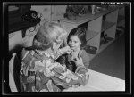 War workers' nursery. Every youngster who attends the Bella Vista Nursery School in Oakland, California must be inspected by Mrs. Elsie Curran, supervisor, before mingling with the other children. Here, five-year-old Ronnie Gold has her chest inspected