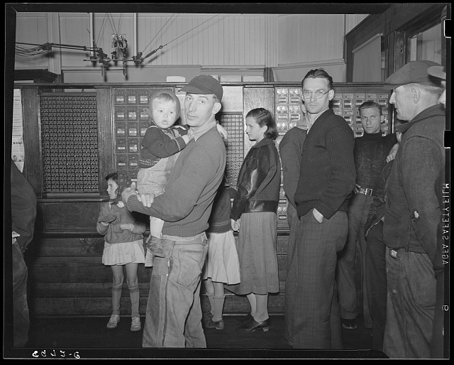 Miners waiting in post office for mail. Kempton, West Virginia