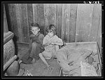 Two children of family living on relief near Jefferson, Texas. These children did not attend school because of lack of warm clothes and indifference of mother who was sick with pellagra. Note baby's cradle
