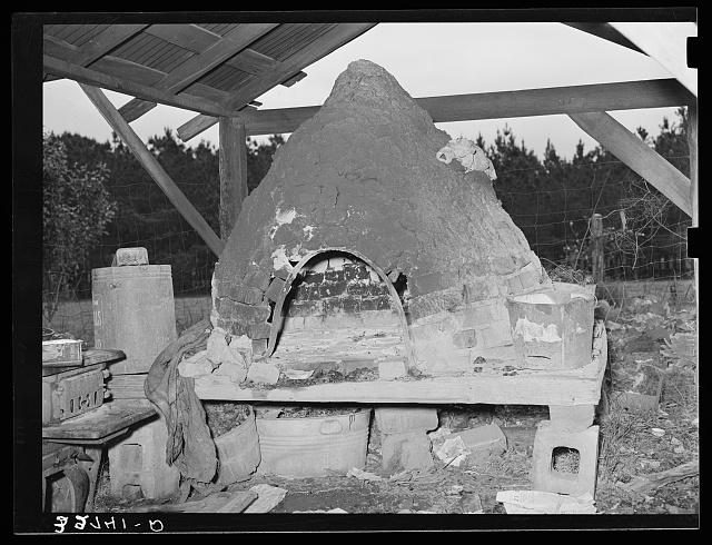 Oven of Italian strawberry grower near Independence, Louisiana. The Italians in this section all have these outdoor ovens and bake all their bread in them