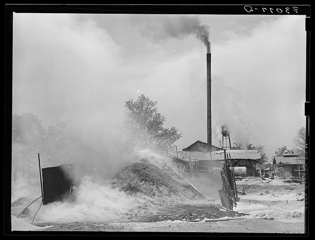 Burning pile of sawdust at sawmill at Wells, Texas