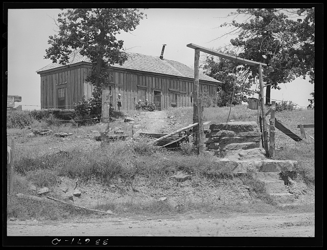 Well and home of tenant farmer near Sallisaw, Oklahoma