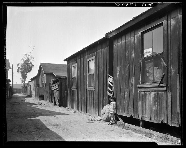 Mexican quarter of Los Angeles. One quarter mile from City Hall. Area has been condemned and will be torn down shortly to make space for the new Union Railroad station. Average rent is eight dollars