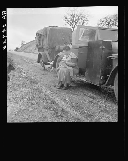 Migrant pea workers on the road. All their worldly possessions in car and trailer. California