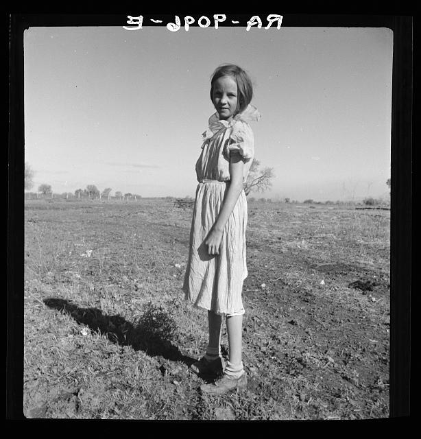 Resettled child of Bosque Farms, New Mexico. She herds cows for neighboring families for five cents per day