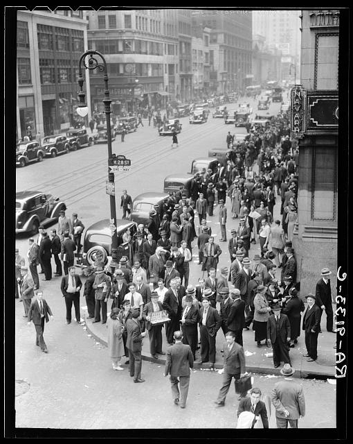 Background for Hightstown project photographs. Seventh Avenue and West 28th Street, New York. Garment workers leave the factories for noon hour