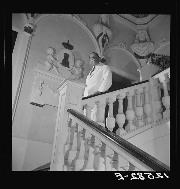 Governor Winship on the staircase of the governor's palace. Puerto Rico