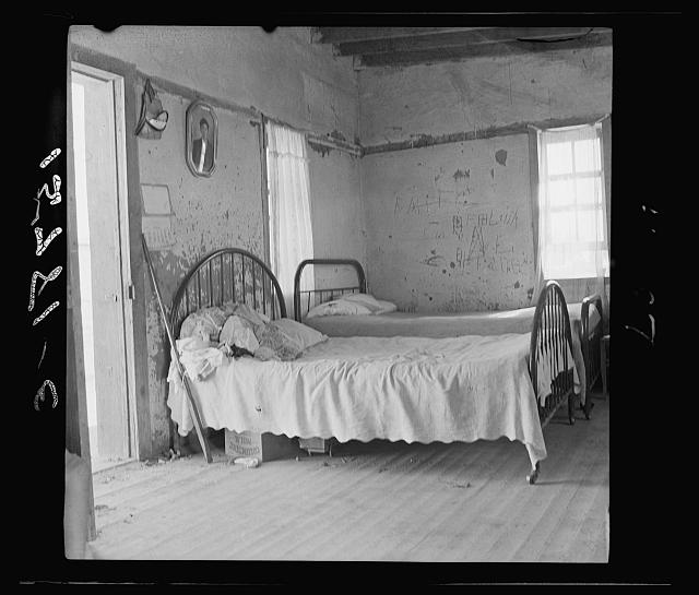 In this single-room house on these two beds sleep the mother, three sisters and the brothers (six altogether). Great Western Sugar Company's beet sugar workers' colony at Hudson, Colorado