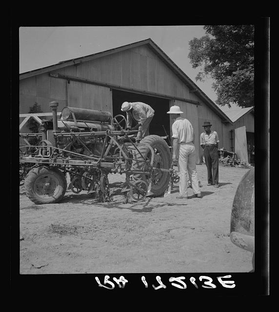 Aldridge Plantation, Mississippi. Tractor drivers are not allowed to do anything but drive tractors. Repairs are made by the mechanic at the plantation garage