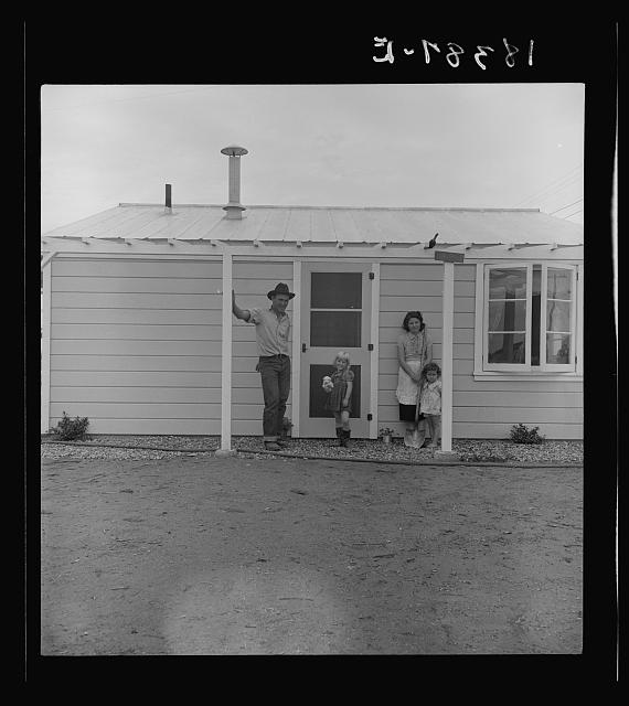 Type of house in Shafter camp for migratory workers, California. These homes represent a first step in stabilization of this group. This is the first family to be selected by Farm Security Administration for housing