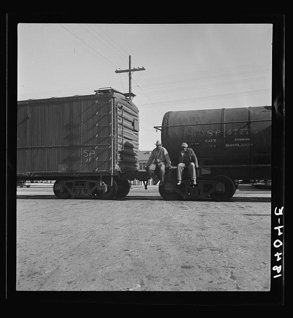 Colored itinerants on oil tank cars passing through Kingsbury, California