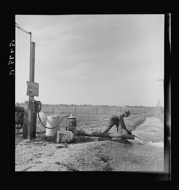 Irrigation pump on edge of field. Electric power typical of San Joaquin Valley farming. Tulare County, California