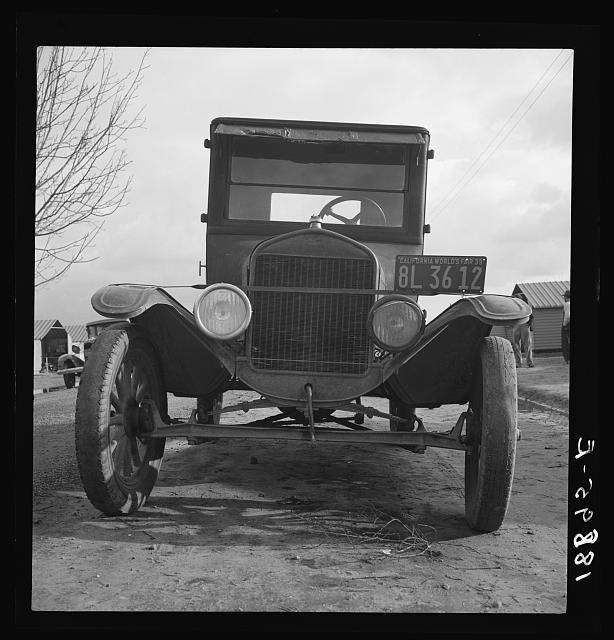 In Farm Security Administration migratory labor camp at Farmersville, California. Model T Fords still carry migrants