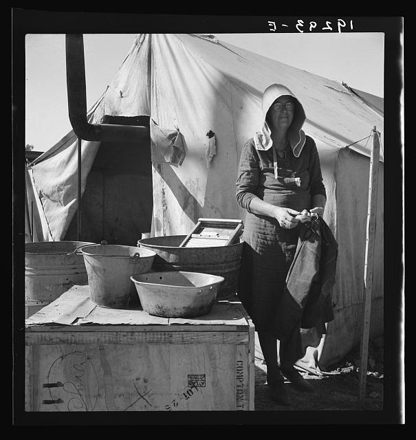 Texas woman in carrot pullers' camp. Imperial Valley, California. This sunbonnet is typical of women who came from Texas