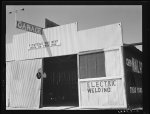 "U.S. 99. Fresno County. ""Pit and tools for rent--work on your own."" California"