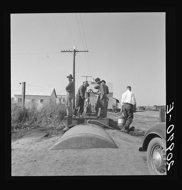 Town pump of Tulelake at railroad yard. Tulelake, Siskiyou County, California. Over 1500 people depend on hauled water for drinking the year round. During potato harvest, this pump also serves the migratory pickers. General caption number 44