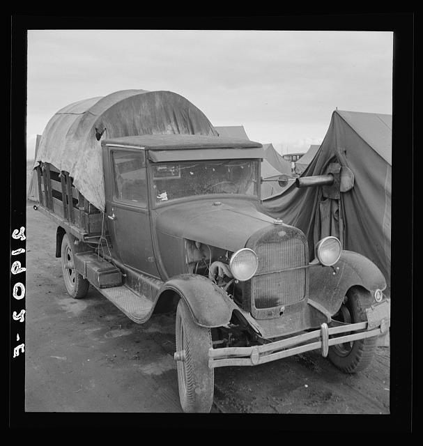 Truck, baby parked on front seat. Merrill, Klamath County, Oregon, in FSA (Farm Security Administration) camp