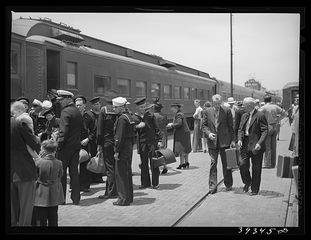 These four photographs were taken at the railroad station when a noon train came in. All trains coming into San Diego are crowded and are an indication of the hordes of people pouring into the city. California