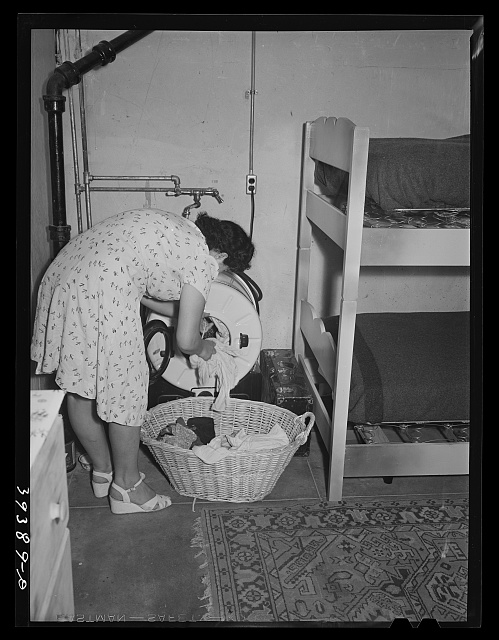 Room for maids who work in boarding house for single men who are mostly employed at the Consolidated Aircrafts. Notice the laundry tub in same room. The maids are paid five dollars per week and room and board. San Diego, California