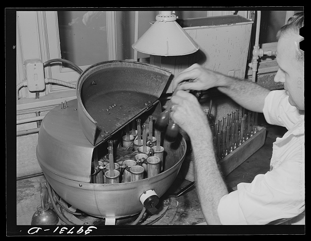 Removing samples of cream from centrifuge used in Babcock test for butterfat. Dairymen's Cooperative Creamery. Caldwell, Canyon County, Idaho