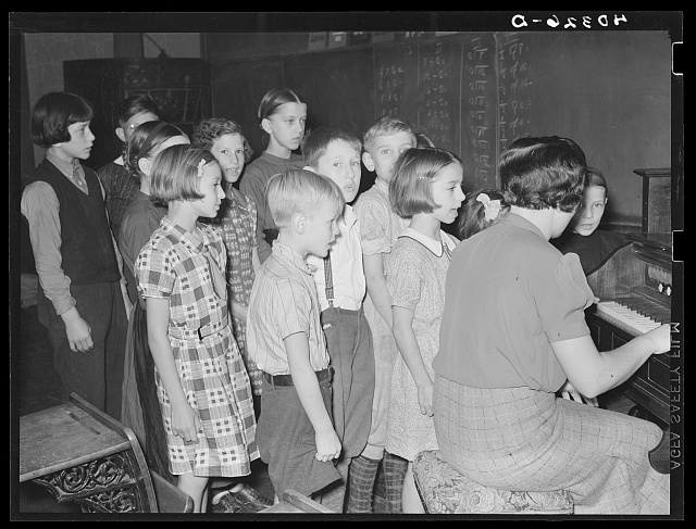 "Lancaster County, Pennsylvania. The children in Martha Royer's school singing the ""Star Spangled Banner."" Notice the Amish boy on the extreme left"