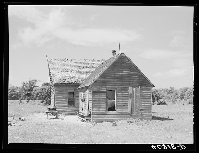 Thirty-five migrants use this farmhouse as their home. Near Old Trap, North Carolina
