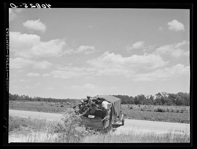 Florida migratory agricultural workers leaving Old Trap, North Carolina for New Jersey. The truck holds thirty-seven persons