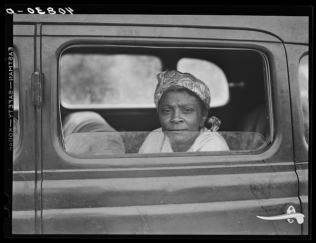 Migratory agricultural worker with seven others in the car on their way to Cranberry, New Jersey, for the potato season