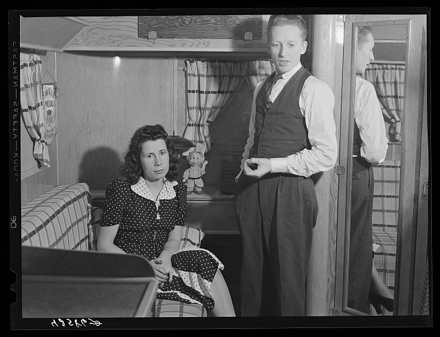 "Mr. and Mrs. C. Farnsworth live in a trailer which they bought about three months ago. He works at the Bath Iron Works. They originally come from Boston and lived in the town of Bath until they found the rents too much for them to meet. In Bath they had rented two small rooms in an attic for six dollars a week (unheated). When their rent was raised they decided to move into a trailer. Their trailer is next to a gas station from which they get their electricity, water and toilet facilities for one dollar fifty cents a week. They do not expect to move into a house but want to continue living in trailers so as to save their money ""while the BOOM lasts."""