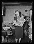 Woman and her child living in slum house in Bridgewater, Pennsylvania. Her husband is a steelworker