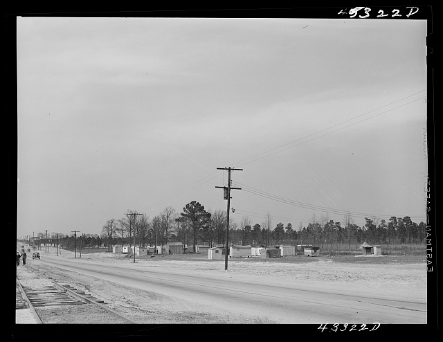 View of a settlement of shacks and trailers occupied by workers from Fort Bragg. Along Fayetteville--Fort Bragg road. North Carolina