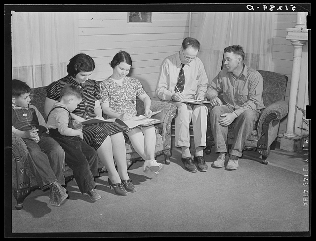 Helms family working out farm and home plan with FSA (Farm Security Administration) supervisor. Coffee County, Alabama
