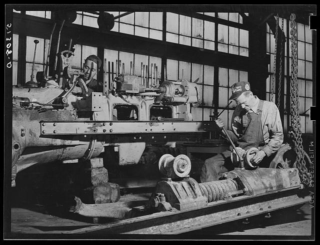 Repairing tractor. FSA (Farm Security Administration) warehouse depot. Atlanta, Georgia