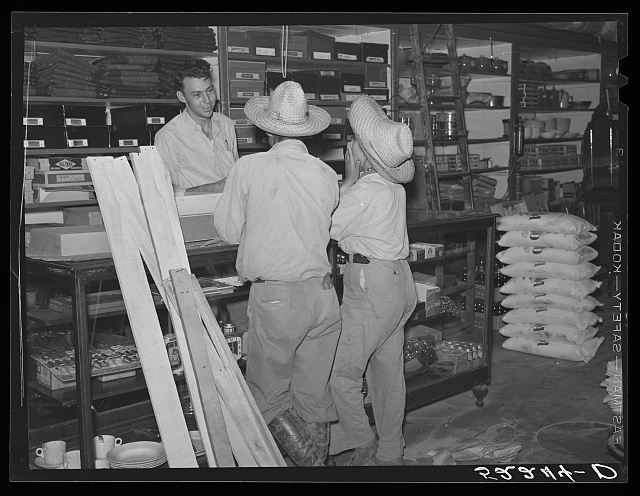 Mexican cotton pickers inside plantation store. Knowlton Plantation, Perthshire, Mississippi Delta. This transient labor is contracted for and brought in trucks from Texas each season