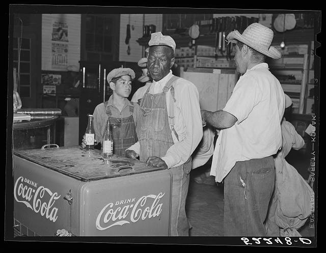 Mexican and Negro cotton pickers inside plantation store, Knowlton Plantation, Perthshire, Mississippi Delta. This transient labor is contracted for and brought in from Texas each season