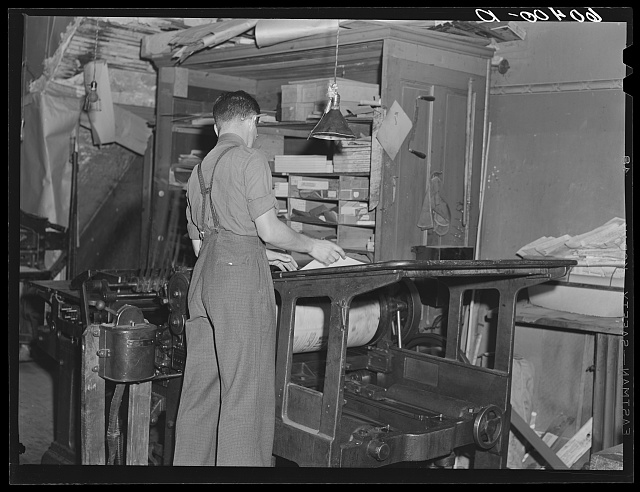 Operating press in office of Litchfield Independent. Litchfield, Minnesota