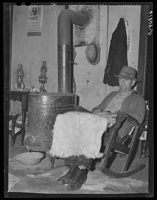 H.C. Richardson, Ozark farmer, with goat skin which has been bleached and washed. He sells these in town, three dollars. Oregon County, Missouri