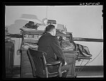 Oran, Missouri. Doctor receiving call in his office