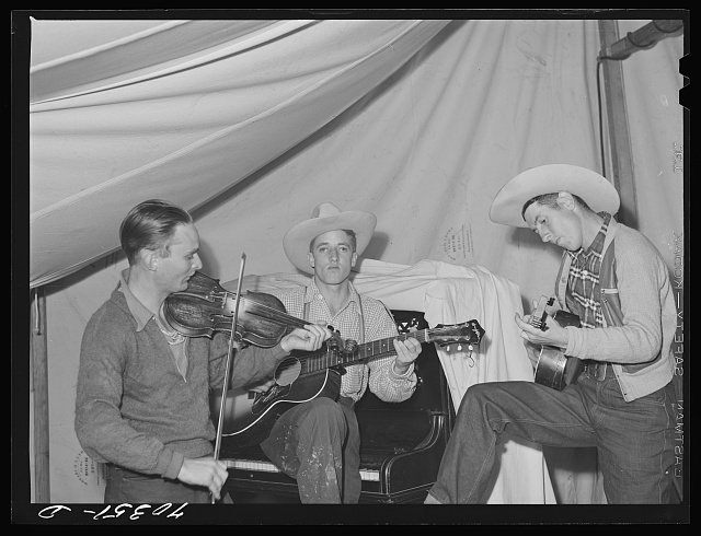 Singing cowboy songs at entertainment at the FSA (Farm Security Administration) mobile camp for migratory farm workers. Odell, Oregon