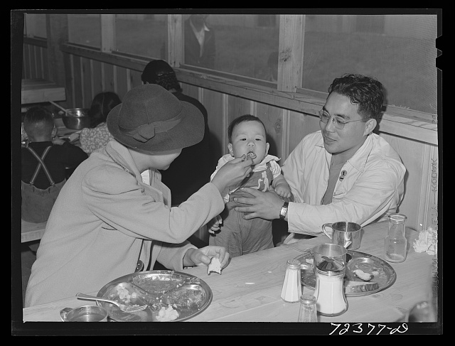 Los Angeles County, California. The evacuation of Japanese-Americans from West coast areas under United States Army war emergency order. Japanese family has its first meal in the mess hall