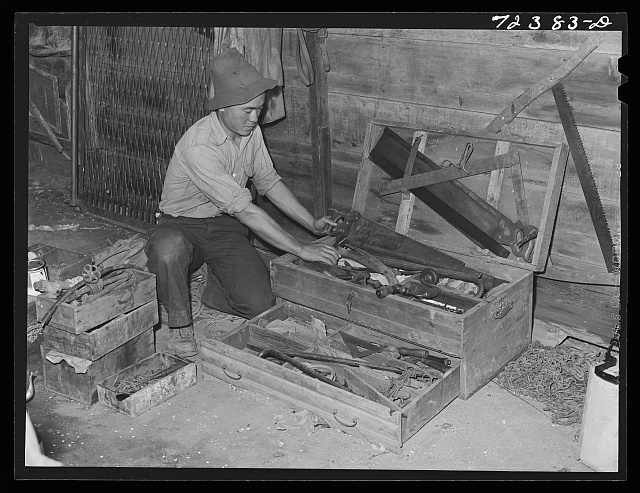 Los Angeles County, California. Japanese farmer packing up his tools before he is evacuated from West coast areas under United States Army war emergency order