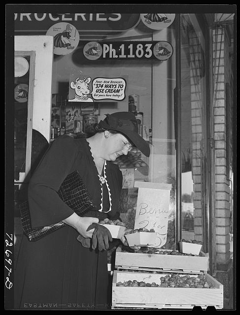 Turlock, California. Housewife shops for groceries. The fact that she no longer uses her automobile on shopping tours doesn't prevent her from comparing values in various stores
