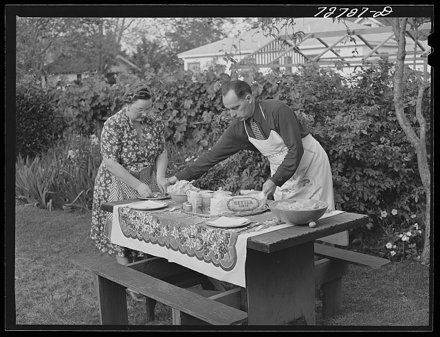 Turlock, California. Husband and wife get ready for dinner in their backyard