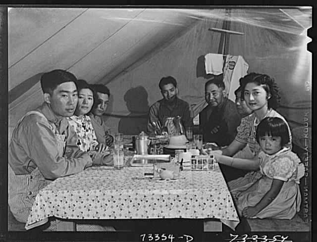 Nyssa, Oregon. FSA (Farm Security Administration) mobile camp. Japanese mother and father with their American-born children in tent-home. One of the sons of this family is in the United States Army. Two of the sons were studying engineering at an American university before the evacuation and are now greatly worried about possibilities of continuing their education