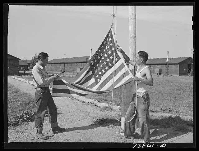 Rupert, Idaho. Former CCC (Civilian Conservation Corps) camp now under FSA (Farm Security Administration) management. Japanese-Americans taking down their flag in the evening