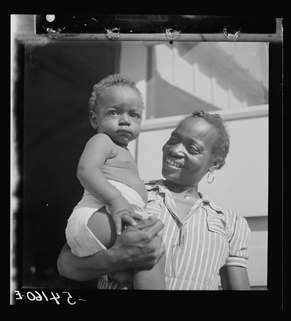 Mother and child at Okeechobee migratory labor camp, where they have a nurse and clinic for prenatal and postnatal care. Belle Glade, Florida