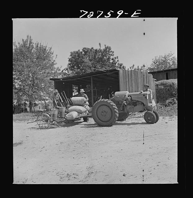 Merced County, California. Sacks of peanuts on planter