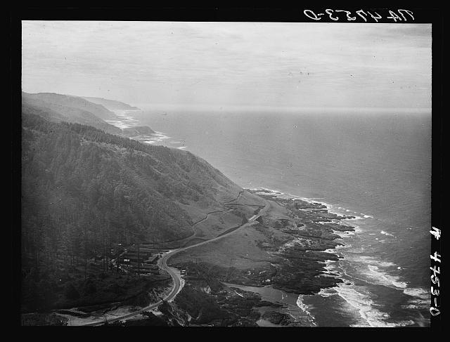 The highway along the Oregon coast should bring many to enjoy the cool forest and ocean. Resettlement Administration work camp at left
