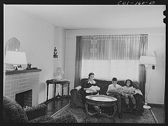 Mrs. Frank Merchant and her children. They have a two-floor apartment--five rooms including kitchen and bath. Mr. Merchant works at the Carnegie Steel Company's South Chicago plant. They have three children: Frank, eight; Rosemary, eight; and baby, four months old. Ida B. Wells Housing Project, Chicago, Illinois